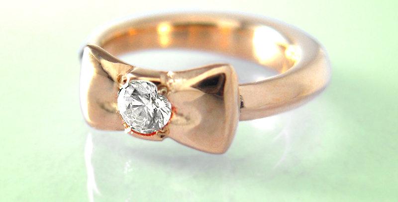 リボンのベビーリング 4月誕生石ダイヤモンド K10PG(10金ピンクゴールド)