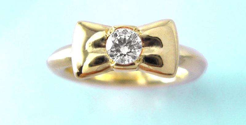リボンのベビーリング 4月誕生石ダイヤモンド K10YG(10金イエローゴールド)