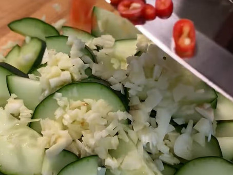 Throwing in random ingredients to make a spicy cucumber salad