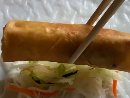 Wrapping an egg roll in rice paper