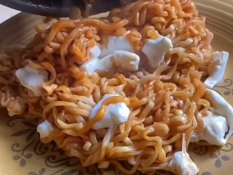 Spicy buldak noodles with fresh mozzarella and fried eggs