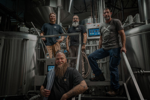 The Garage Brewing team working in our brewery making craft beer