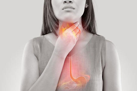 Woman Suffering From Acid Reflux Or Hear