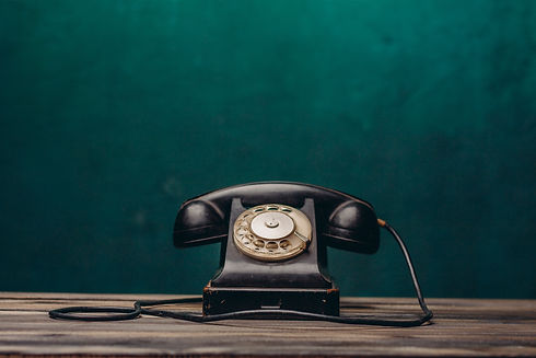 old black telephone on dark background.j