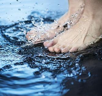 Feet in water of foot bath