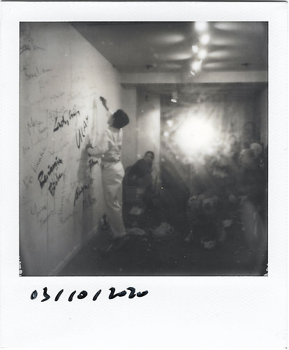 Polaroid by Alexander Si. Artist Alexander Si installation view at Chinatown Soup, Lower East Side, New York, curated by Ventiko, with ropes, chains, celebrity names on wall