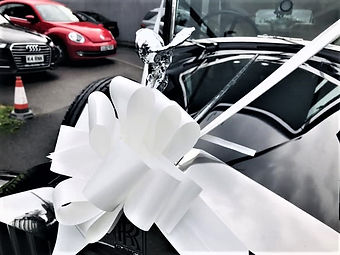 Rolls_Royce_White_Ribbon_Bow.jpg