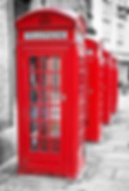 Row of iconic London red phone cabins wi