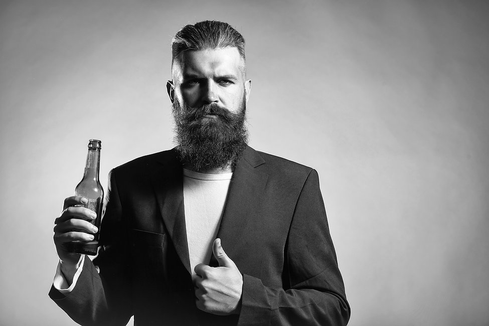 Handsome young man with long beard and m