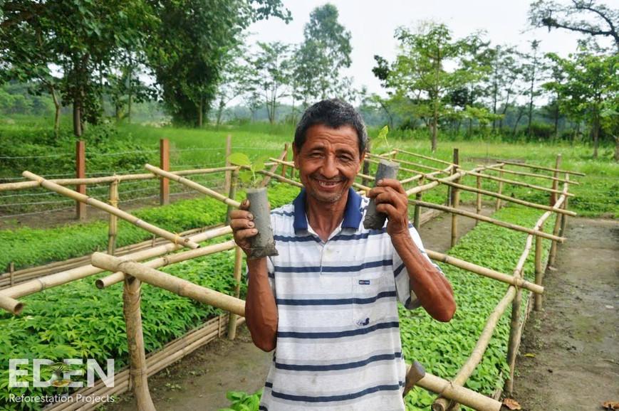 Nepal_2015_Man in nursery holding seedli