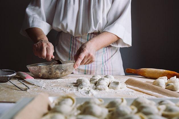 two-hands-making-meat-dumplings-PZFH6CC.