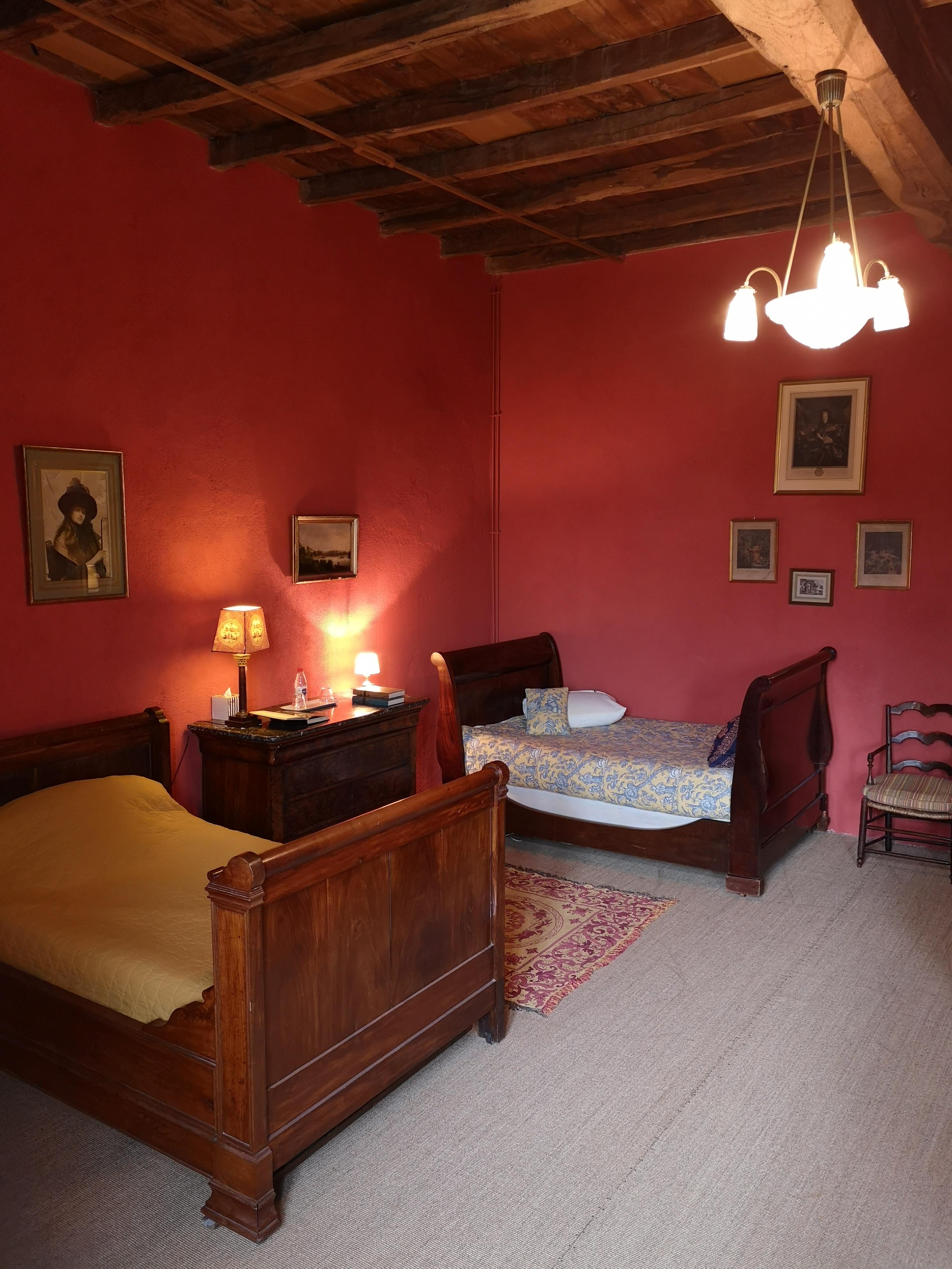 2 lits simples salon Baldaquin
