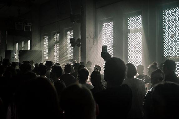 Audience in a Dark Room