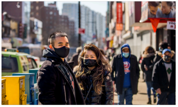Sam and Maggie Cheng on the street where their  mother was attacked last week in Flushing, Queens.  Andrew Seng for The New York Times