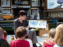 DOC Ranger reading whio story to children