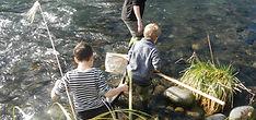 Children entering stream to take samples