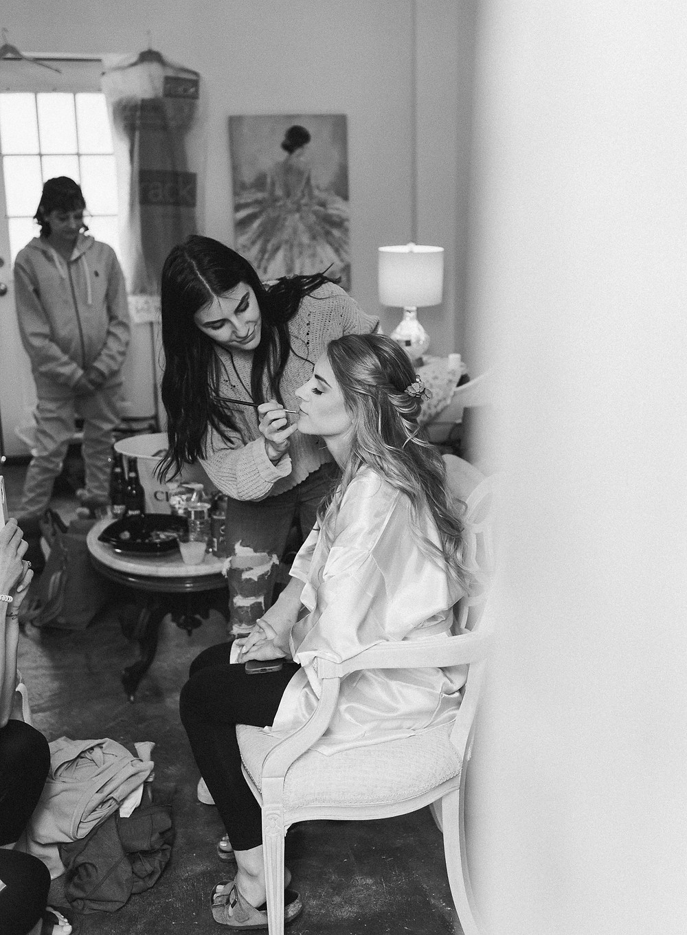 Black and white portrait of the bride getting ready.