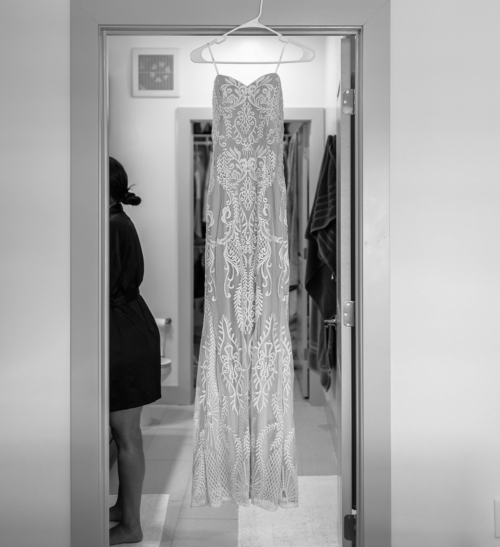 The bride's wedding dress waiting to be put on.