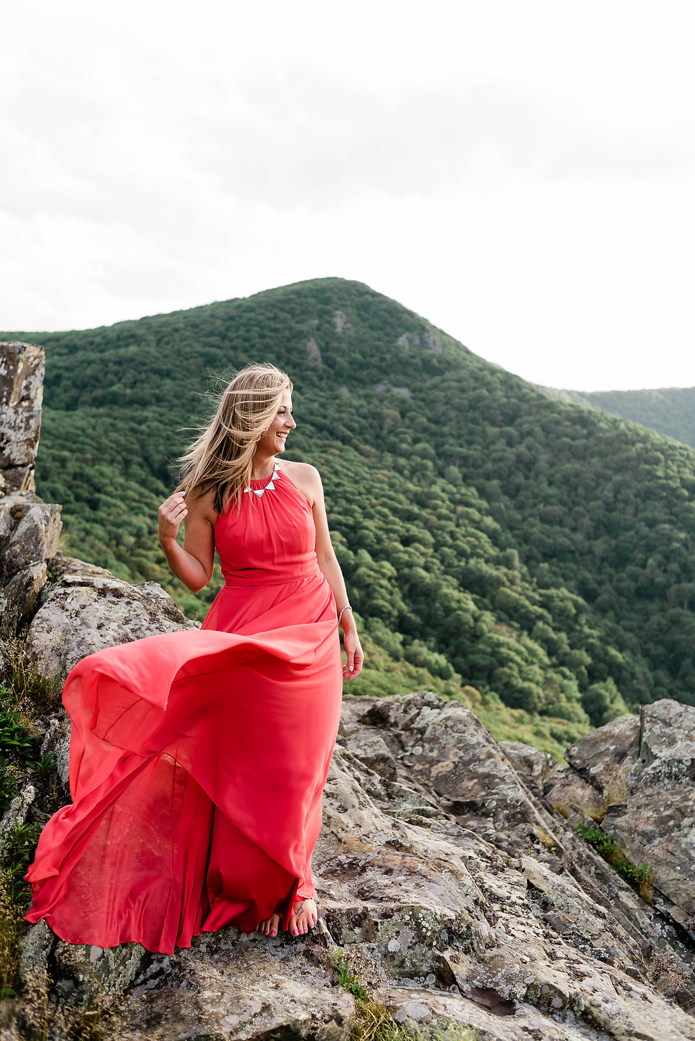 A portrait of the bride to be, wearing a beautiful and flowing red gown.