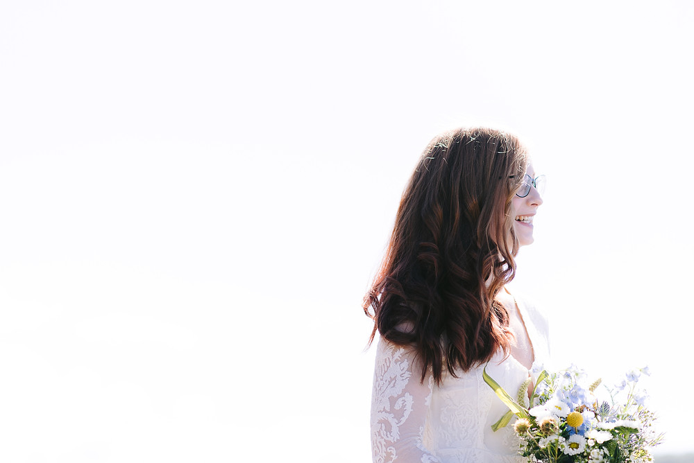 A portrait of the bride with a huge smile on her face.