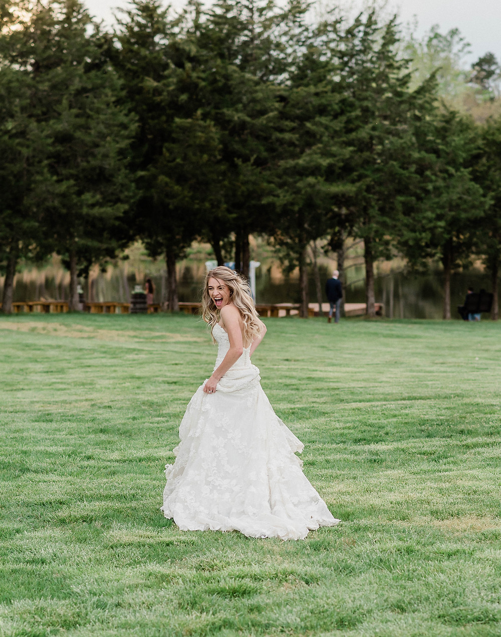 Portrait of the bride running from the camera