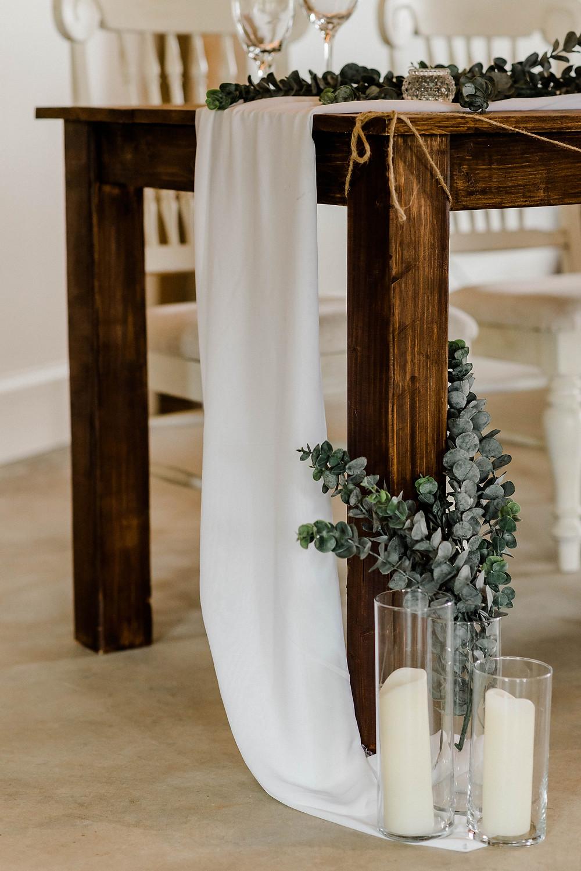 Draped table cloth, rustic barn table, sweetheart table.