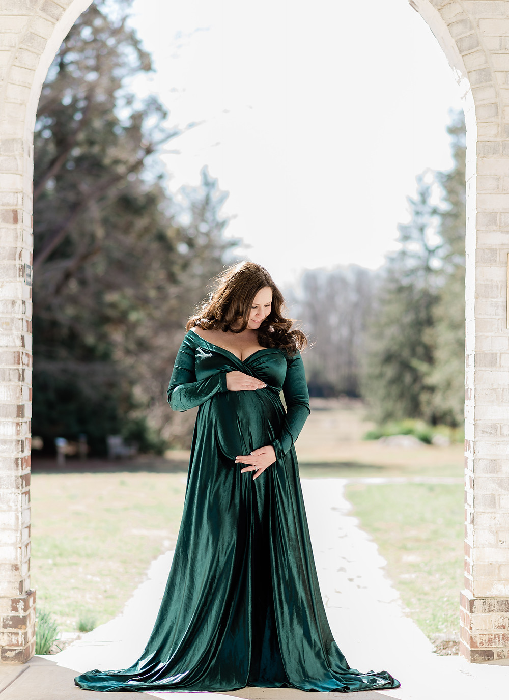 maternity photo under an archway