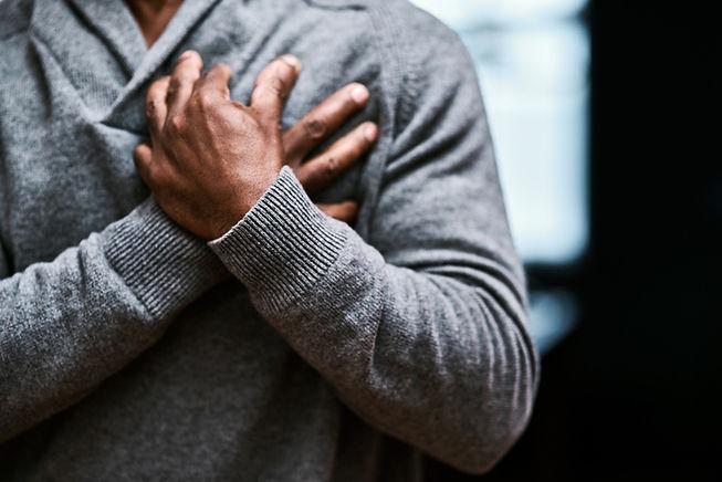 ckupload_20180621193037_man_gripping_chest_in_pain.jpg
