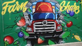 Farm Share Breaks Through Mural
