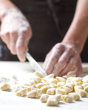 Hands working on Italian pasta, gnocchi.