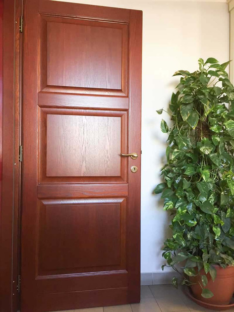 porta legno massello tre bugne