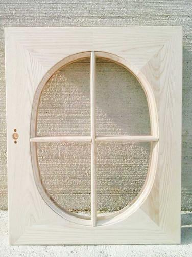 finestra grezza legno massello con telaietto ovale per vetro