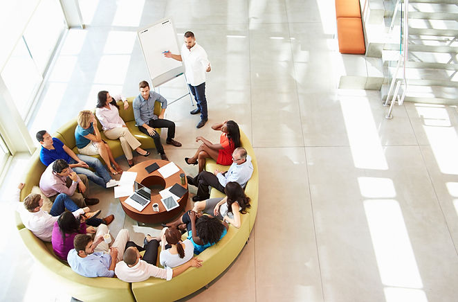 group of employees discussing private medical insurance