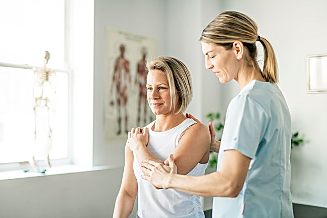 physiotherapist providing help to an employee as part of an occupational health programme