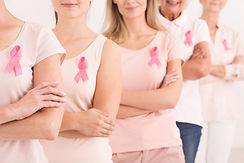 charity workers wearing pink ribbons