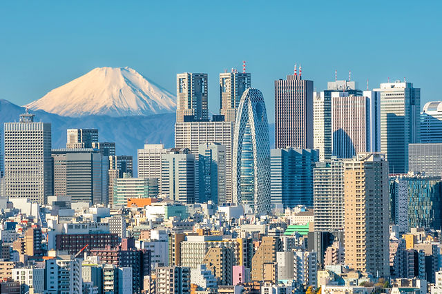 Panoramic view of Tokyo skyscrapers with Mount Fuji in background promoting international private medical insurance