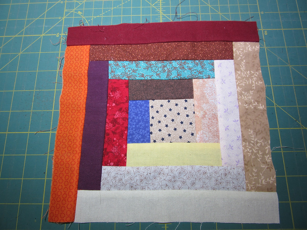 Start with an unfinished Log Cabin block, this one is 9 inches.