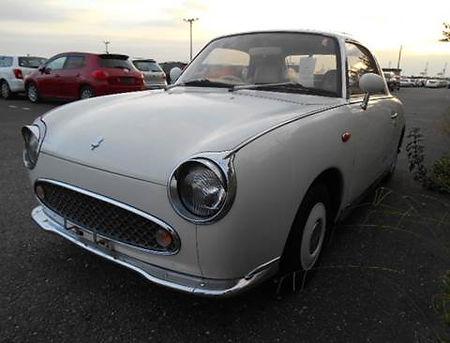 White Nissan Figaro