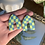 Thumbnail: chartreuse and teal checkered pointed arch studs