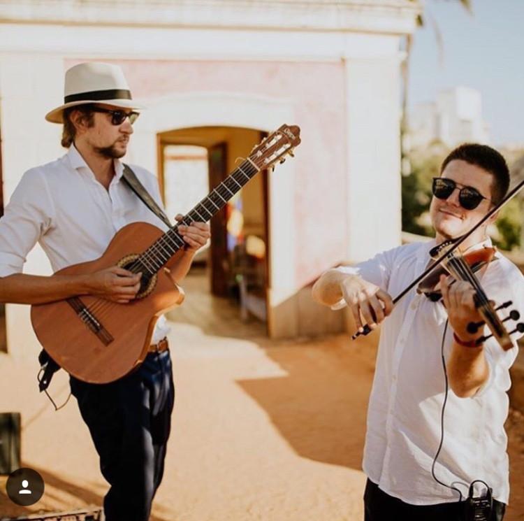 Classical Guitarist and Violinist playing music at Cocktail Reception in Pousada De Estoi Wedding Venue Faro Algarve Portugal