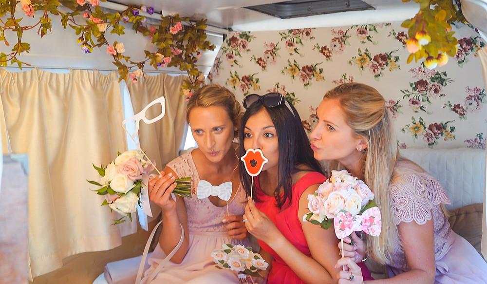 Bridemaids in photo booth Volkswagen during wedding Algarve Portugal