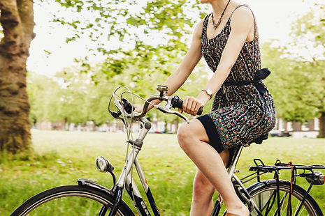 woman%20riding%20bicycle%20near%20grass_