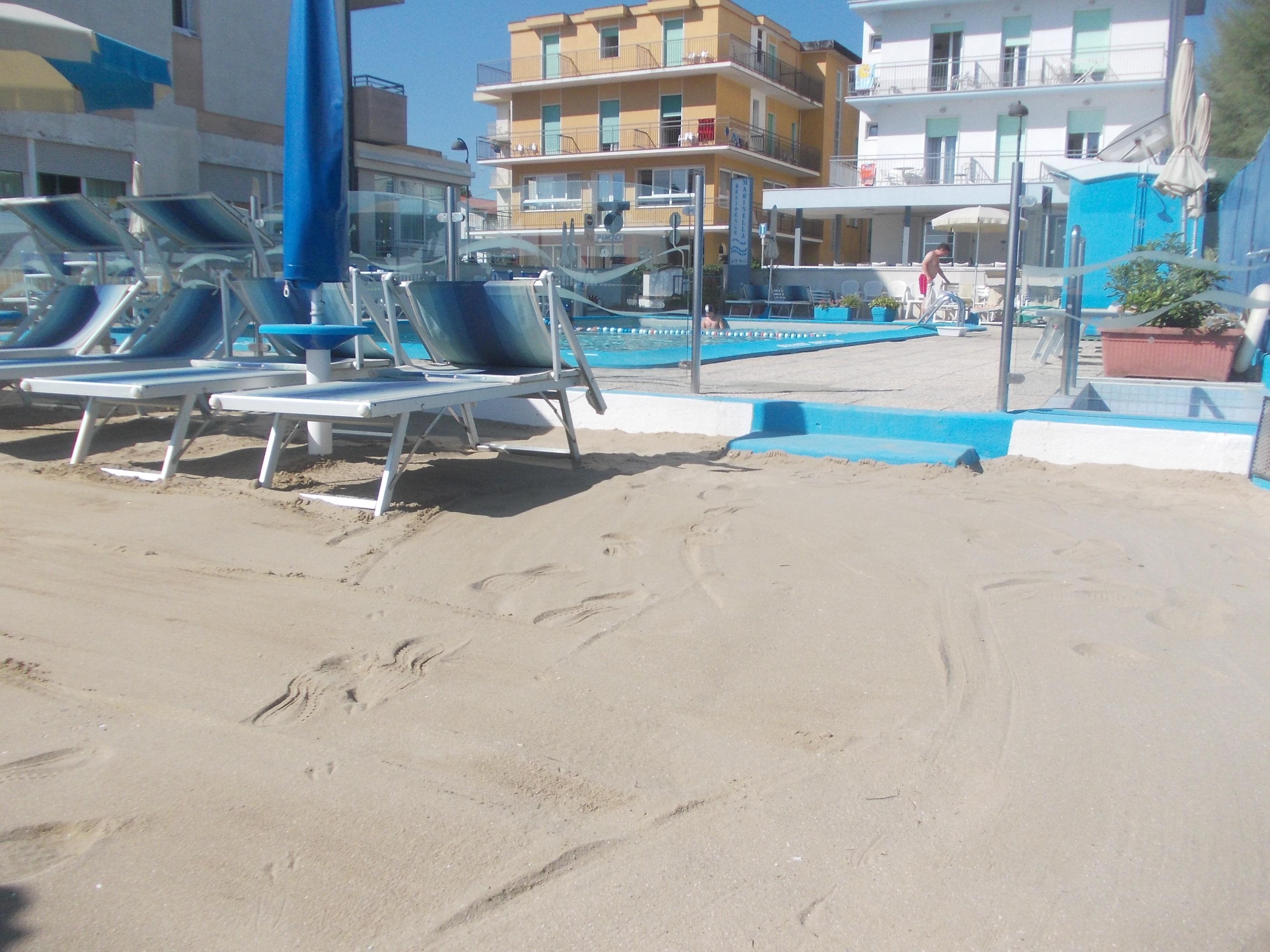 spiaggia privata con sabbia di mare
