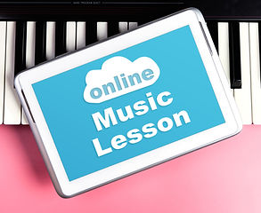 Online Music lesson on tablet screen wit