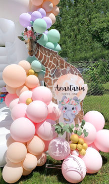 Welcome Sign and Oversized Giraffe Print