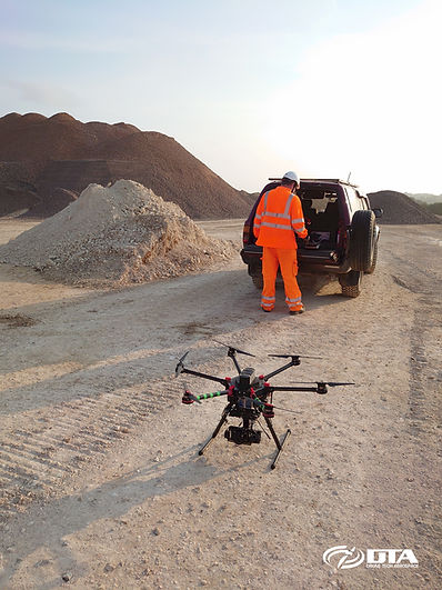 DTA's TopographicalSurvey Drone Gen3 and one of our all-terrain 4x4 trucks in action.