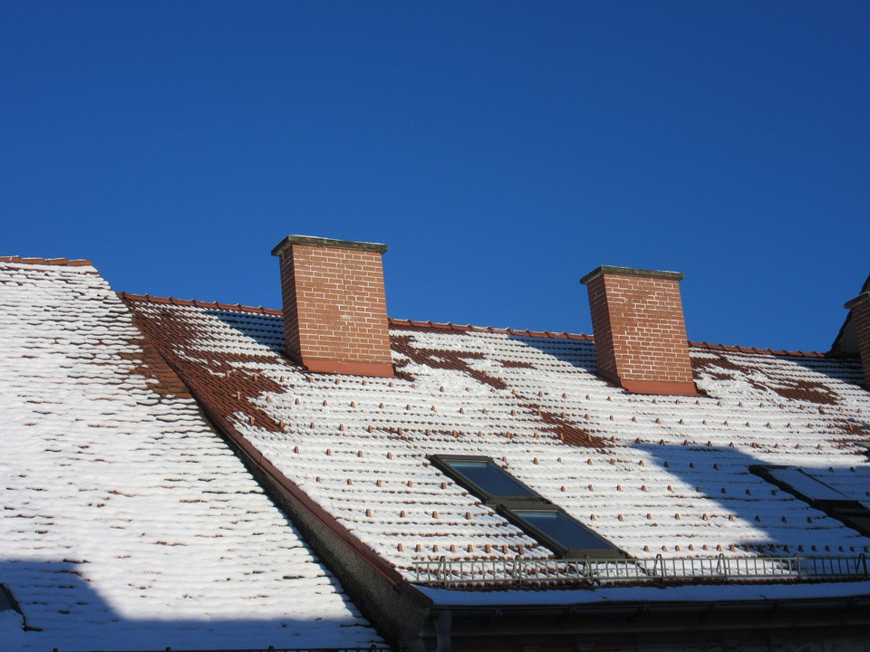 snow roof winter roofing leak damage