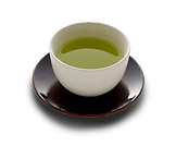 Green tea in Small handless cup in saucer