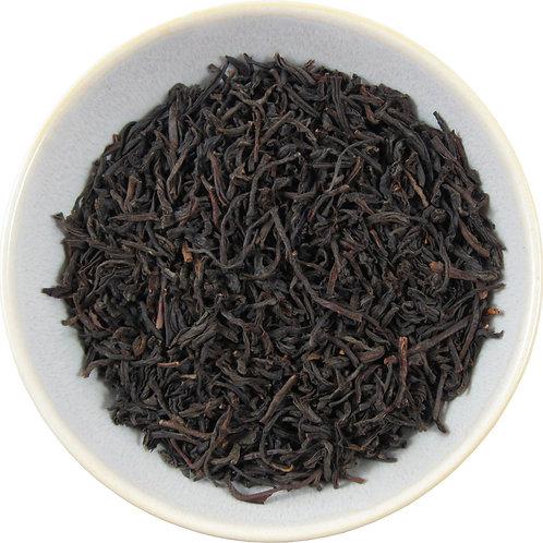 "Dark black brown tea leaves thin strip leaf about 1/2"" long"