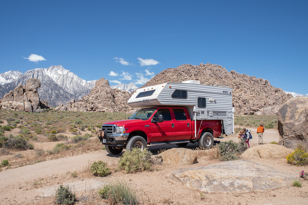 Picture of a truck with a camper in the Alabama Hills area of CA